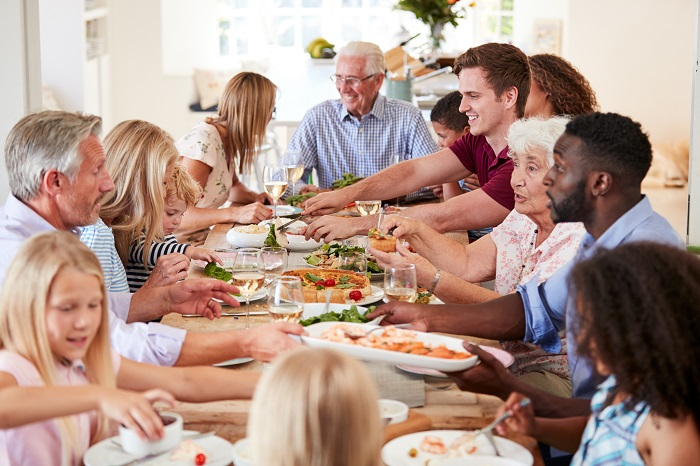 enjoying meal with loved ones will increase conscious eating